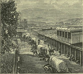 Gillum Baley - 19th-century depiction of wagon trains entering Santa Fe, New Mexico