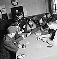 American volunteer pilots of No.121 (Eagle) Squadron playing poker in the dispersal hut at RAF Rochford in Essex during August 1942. D9514.jpg