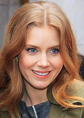 A close-up shot of a smiling Amy Adams