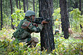 An Indian Army soldier with the 99th Mountain Brigade fires at role-playing insurgents during bilateral training with U.S. paratroopers in 2013.jpg
