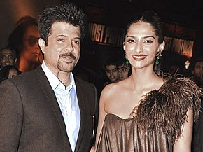 Sonam Kapoor and her father Anil Kapoor posing for the camera