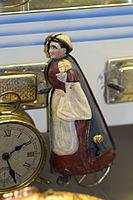 Antique wind-up tin toy shopper on wheels (25741532606).jpg