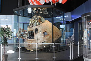 U.S. Space & Rocket Center - Apollo 16 capsule is on display, with the recovery parachute hanging above it.