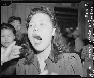 Throat - A throat examination performed on a Japanese woman at the Santa Anita Assembly Center (1942).