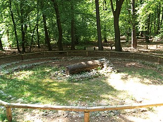 Secondary burial - Partially reconstructed tree trunk burial - without burial mound - with a secondary burial in a semi-circular extension (background: centre left)