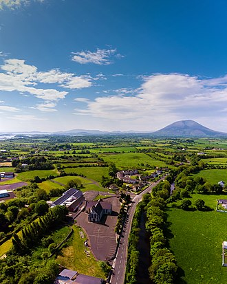 Crossmolina - Aerial view of Crossmolina. In the distance is Saint Tiernan's Church and the mountain Nephin.