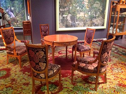Table and chairs by maurice dufrene and carpet by paul follot at the 1912 salon des artistes décorateurs art deco