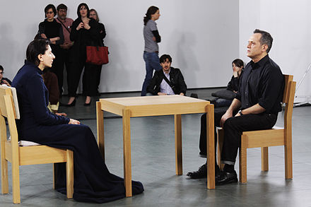 Marina Abramovic performing The Artist Is Present, Museum of Modern Art, New York, 2010 ArtistIsPresent.jpg