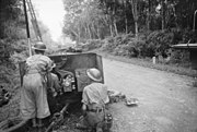 Australian 2-pdr anti-tank gun in action at Bakri on the Muar-Parit Sulong Road