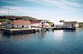 BATTLE HARBOUR L to R STORES, MISSION, HERRING, SALMON, Port Hope Simpson Off The Beaten Path Llewelyn Pritchard.jpg
