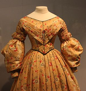 1830s in Western fashion - By the later 1830s, fullness was moving from the upper to the lower sleeves.  This morning dress of 1836–40 features shirring on the fitted upper sleeves; Victoria and Albert Museum.