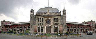 Originally opened in 1873 with a smaller terminal building as the main terminus of the Rumelia (Balkan) Railway of the Ottoman Empire, which connected Istanbul with Vienna, the current Sirkeci Terminal building was constructed between 1888 and 1890, and became the eastern terminus of the Orient Express from Paris. Bahnhofsfront-Istanbul-Sirkeci retouched 2.jpg
