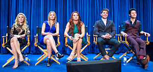 Katie Stevens - Stevens with her Faking It co-stars in September 2014.