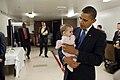Barack Obama holds House Speaker Nancy Pelosi's granddaughter, 2009.jpg