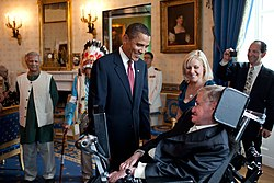 Barack Obama talking to Stehen Hawking in the White House