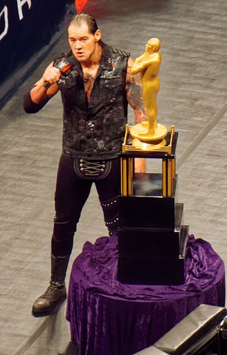 Baron Corbin - Corbin with the André the Giant Memorial Trophy
