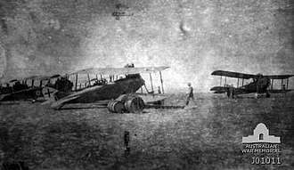 Capture of Afulah and Beisan - Four captured German DFW CB biplanes and British Armstrong Whitworth FK8 Serial 3634 in background at Afulah aerodrome