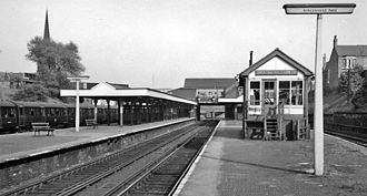 Birkenhead Park railway station - Birkenhead Park station in 1961, with the signal box on the platform to the right, and the northern platform to the left.