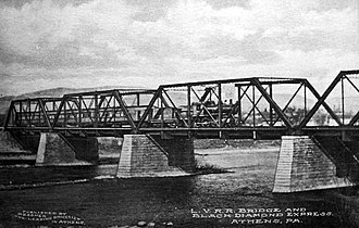 Waverly, Tioga County, New York - The Black Diamond Express crossing the Susquehanna bridge in Athens, PA, just a few miles to the south, and part of the greater town.