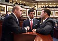Blaise Ingoglia, José R. Oliva, and Chris Sprowls huddle on the House floor.jpg