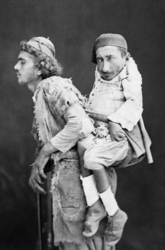 Disability in the media - A blind man carrying a paralyzed man on his back in the Levant, photo by Tancrède Dumas, circa 1889.