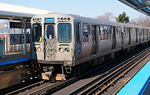 Blue Line (CTA) - A Blue Line train of 2600-series cars at California station on the O'Hare branch in April 2015.
