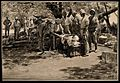 Boer War; a military physician bandages a wounded man in the Wellcome V0015585.jpg