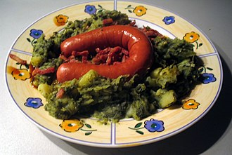 Stamppot - A boerenkool (curly kale) stamppot served with traditional rookworst (smoked sausage)