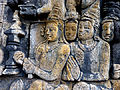 Borobudur - Lalitavistara - 114 E, The Buddha is entertained by Householders (detail 3) (11248643936).jpg