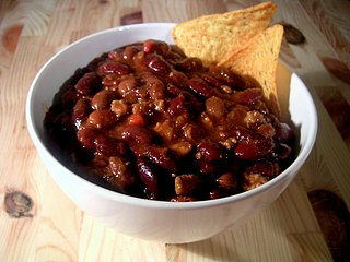 Chili con carne soup-like stew with chili peppers or chili powder