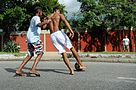 Boys playing street football 01.jpg