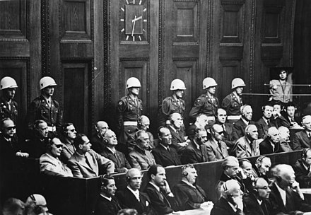 The Nuremberg defendants listen to the proceedings (Speer, top seated row, fifth from right) - Albert Speer