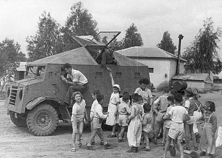 "A ""Butterfly"" improvised armored car of the Haganah at Kibbutz Dorot in the Negev, Israel 1948. The armored car is based on CMP-15 truck. The car has brought supply to the kibbutz. The Negev Kibbutz's