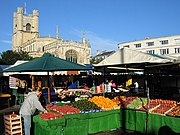 The market in the centre of Cambridge, with Great St Mary's Church in the background · more