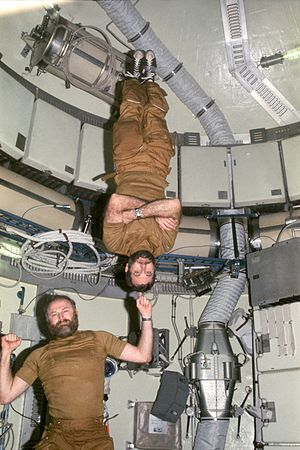 Gerald P. Carr - Carr demonstrates weightlessness by balancing Skylab 4 crewmate William R. Pogue on his finger