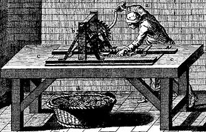 An illustration of a man operating a crank-powered machine