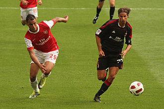 Luca Antonini - Antonini (right) and Marouane Chamakh of Arsenal in action for the Emirates Cup 2010