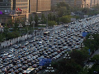 Conventional bus services being delayed by traffic congestion on Chang'an Avenue in Beijing Chang'an avenue in Beijing.jpg