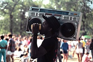 Boombox - A man holding a boombox in 1985