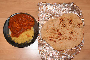 Balti (food) - Balti chicken with rice and naan served at a balti restaurant in Edinburgh, Scotland