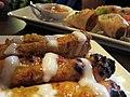 Chicken satay and spring rolls (9687966741).jpg