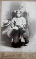 Child in chair by Revere Studio of 98 Court Street in Boston.png