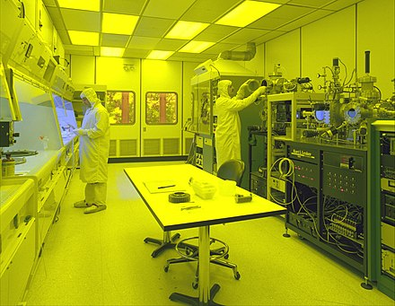 Cleanroom used for the production of microsystems. The yellow (red-green) lighting is necessary for photolithography, to prevent unwanted exposure of photoresist to light of shorter wavelengths. Clean room.jpg