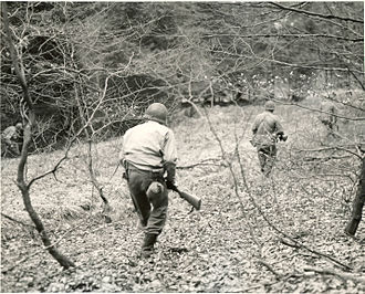 Operation Stösser - A patrol of Company F, 3rd Battalion, 18th Infantry Regiment, 1st Infantry Division, searches the woods between Eupen and Butgenbach, Belgium, for German parachutists