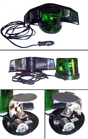 Emergency vehicle lighting - The parts and workings of a rotating light: Top The assembled beacon, including an optional mirror to be used when the beacon is placed in the windshield or rear window. Center The beacon, with the mirror removed. Bottom left and right The green dome of the beacon has been removed to show its rotating reflector, stationary incandescent lamp, and electric motor.