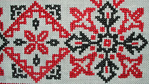Cross-stitch - Detail of floral border pattern in cotton. Tea cloth (small tablecloth), Hungary, mid-twentieth century
