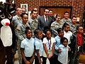 DC Mayor Vincent Gray poses with Rudolph the Red-nosed Reindeer; volunteer military and civilian workers from Joint Base Anacostia-Bolling (JBAB) 131218-N-CG900-004.jpg