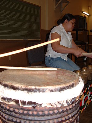 Dabakan - Proper way of hitting the dabakan's drumhead parallel to its surface with a pair of rattan.