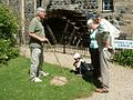 Dalgarven Mill Waterwheel and members of the public at a Guided Tour.jpg