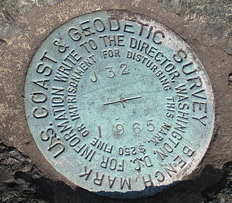 U.S. National Geodetic Survey - Closeup of a United States Coast and Geodetic Survey marker embedded in a large rock in front of the Noroton Volunteer Fire Department in Darien, Connecticut.